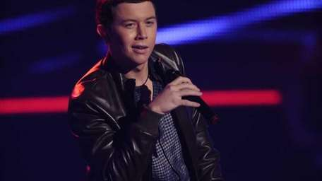 Scott McCreery performs for the judges in the