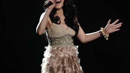 Thia Megia performs for the judges on