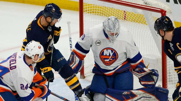 Sabres forward Jason Pominville is stopped by Islanders