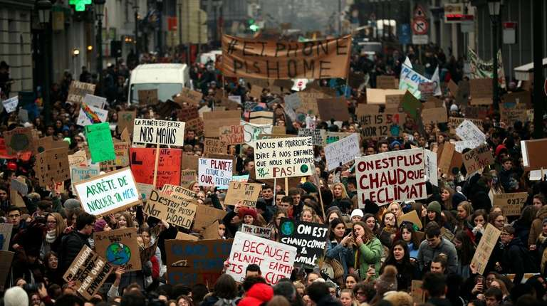 Thousands of youngsters march during a climate change