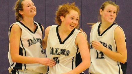 Farmingdale High School #33 Colleen Reyonds, center, celebrates