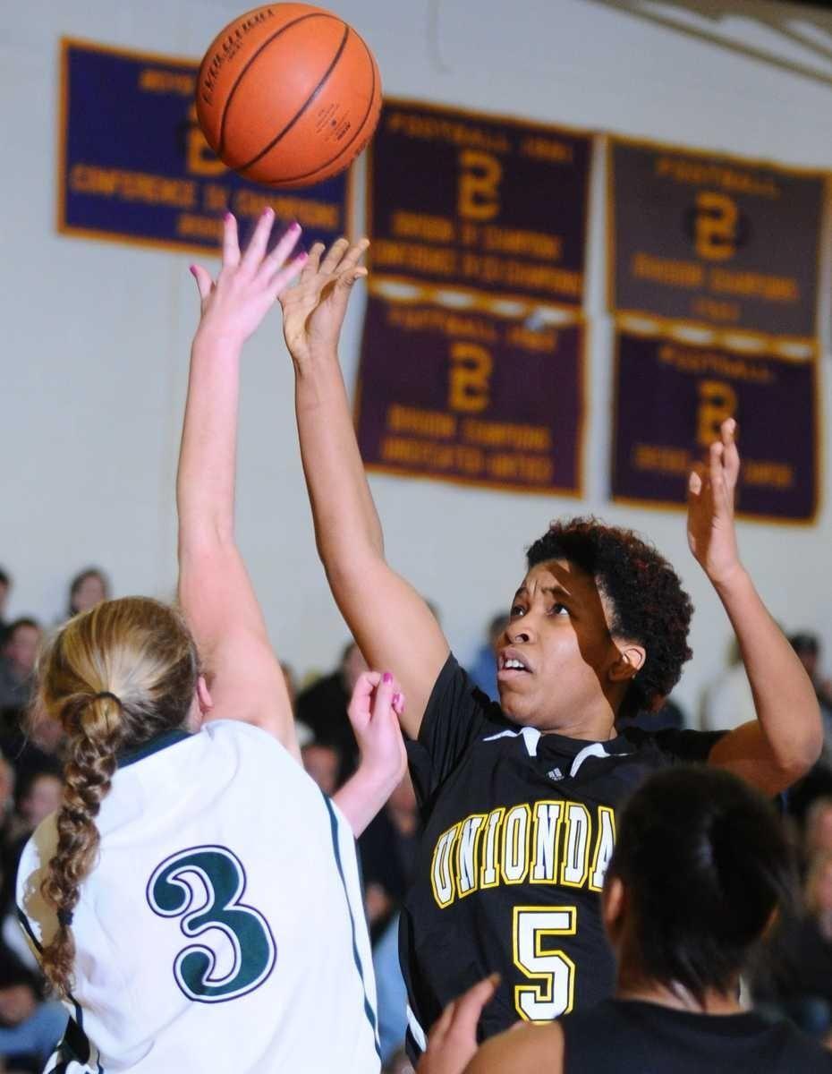 Uniondale High School #5 Myajha Elston, right, tries