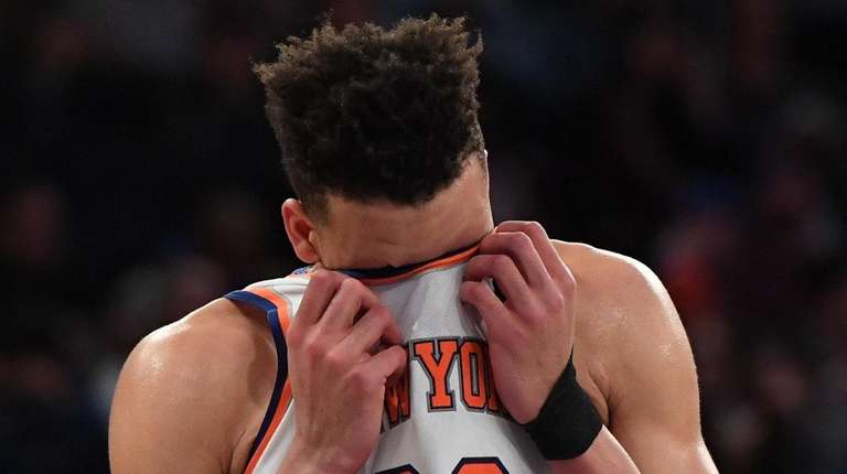 Knicks forward Kevin Knox wipes the sweat from