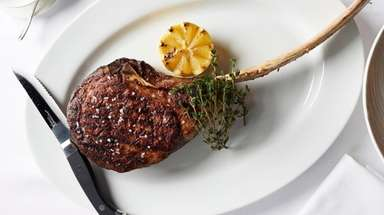 "The 40-ounce ""tomahawk"" rib steak for two heads"