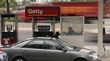 Attendant Jarnial Singh pumps regular gasoline at a