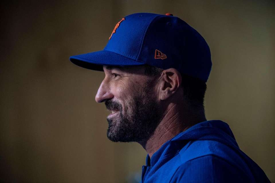 New York Mets manager Mickey Callaway talks to