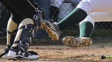 High school softball players can wear rubber cleats