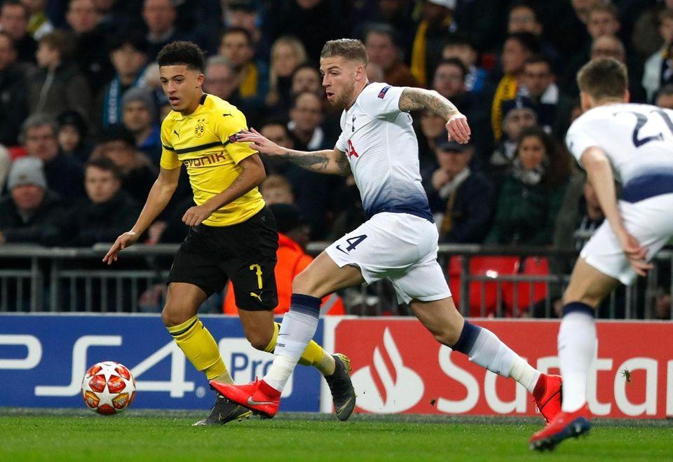Dortmund forward Jadon Sancho, left, vies for the