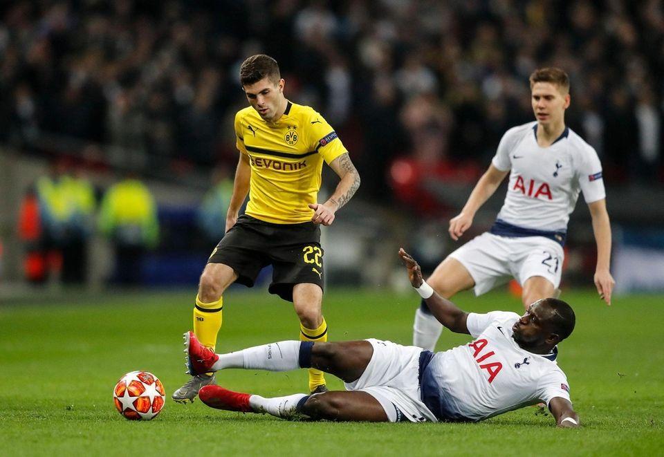 Tottenham midfielder Moussa Sissoko, down, and Dortmund midfielder
