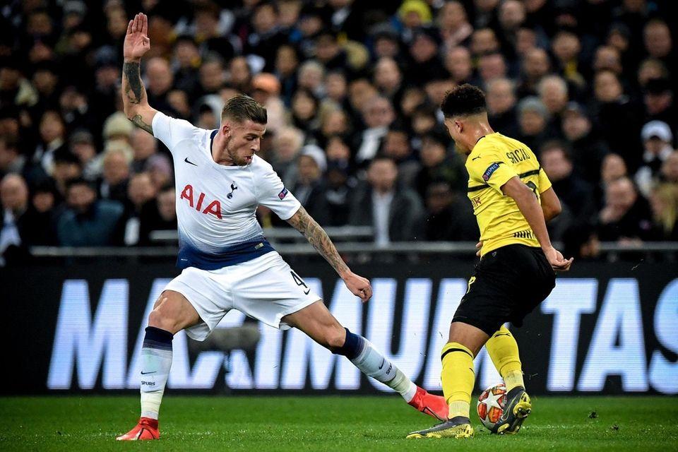 Tottenham's Toby Alderweireld (L) in action against Dortmund's