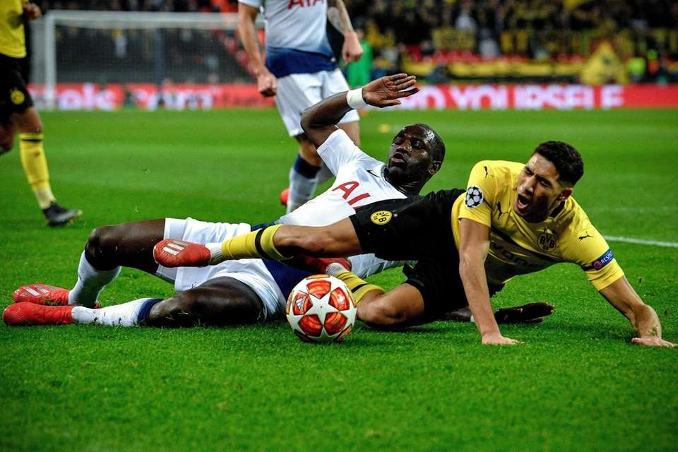 Tottenham's Serge Aurier (rear) in action against Dortmund's