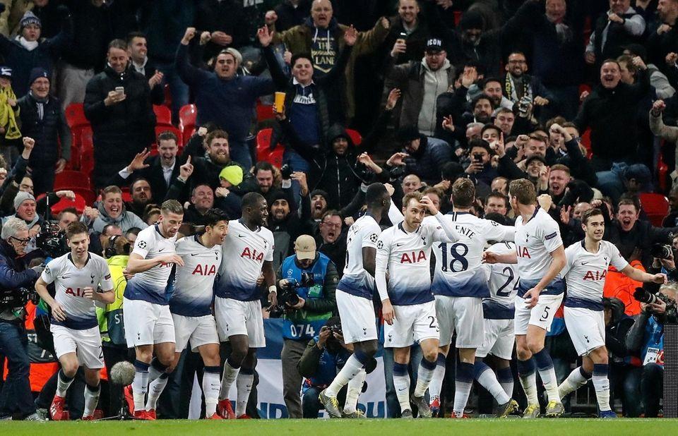 Tottenham celebrates after scoring their third goal during