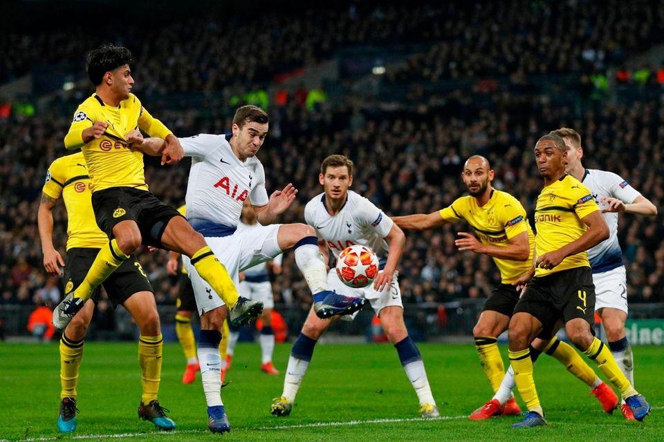 Dortmund's German midfielder Mahmoud Dahoud (L) and Tottenham