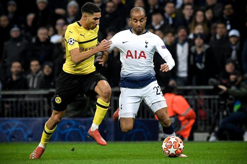 Dortmund's Achraf Hakimi (L) in action against Tottenham's