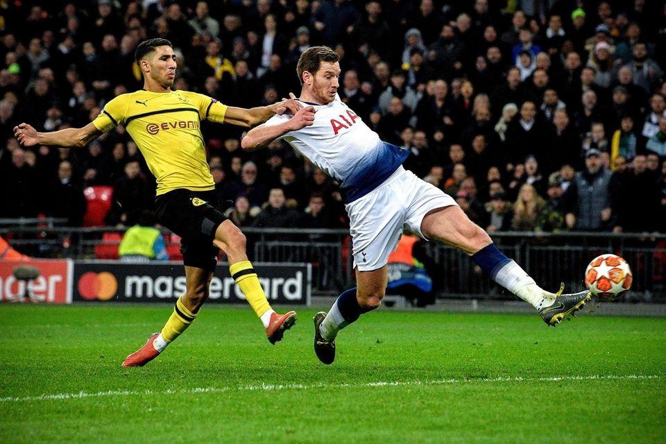 Tottenham's Jan Vertonghen (R) in action against Dortmund's
