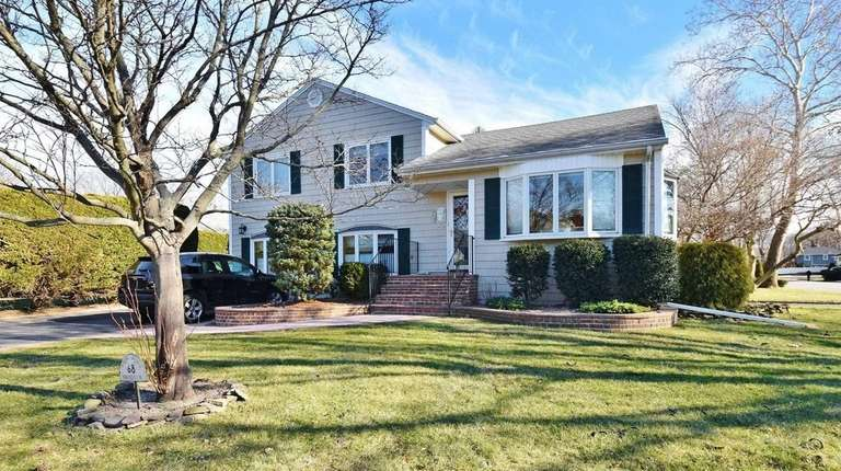 This split-level, for $825,000, includes three bedrooms and