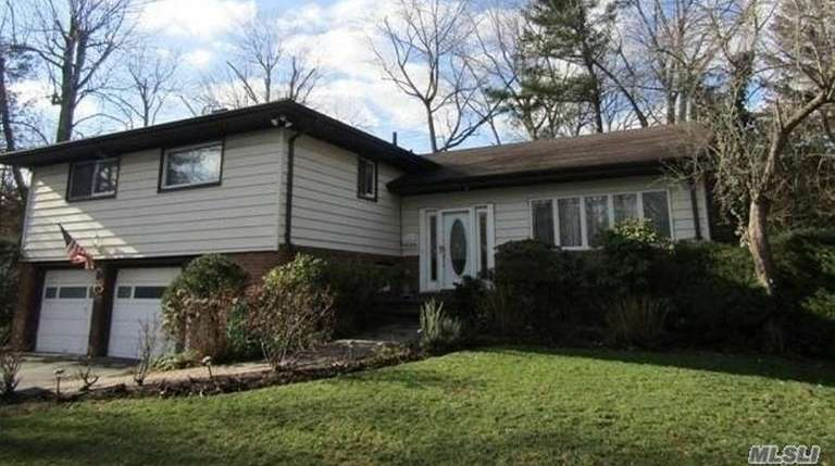 This split-level, with three bedrooms and 2-1/2 bathrooms,