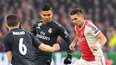 Ajax's Serbian forward Dusan Tadic (R) fights for