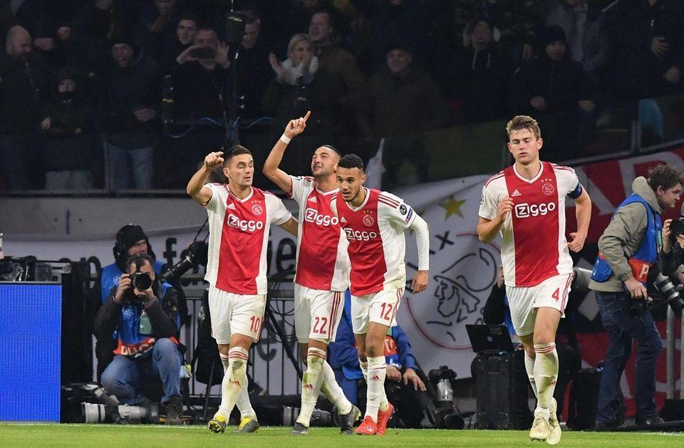 Ajax's Moroccan midfielder Hakim Ziyech (2nd L) celebrates
