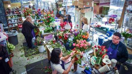 Florists prepare arrangements for Valentines Day at the