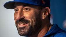 Mets manager Mickey Callaway talks to reporters on