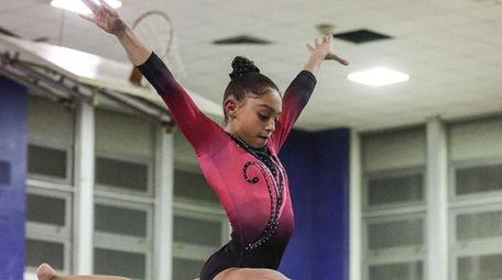Syosset's Jenna Kolberg, on the beam here, won