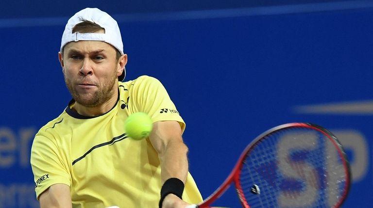 Moldava's Radu Albot returns the ball to Latvia's