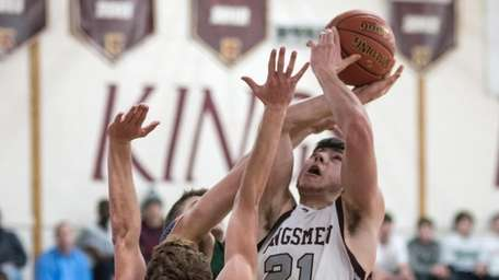 Kings Park's Andrew Bianco scores over Harborfields during