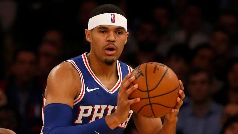 Tobias Harris of the 76ers controls the ball