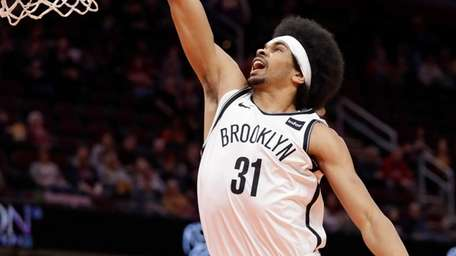The Nets' Jarrett Allen dunks against the Cavaliers