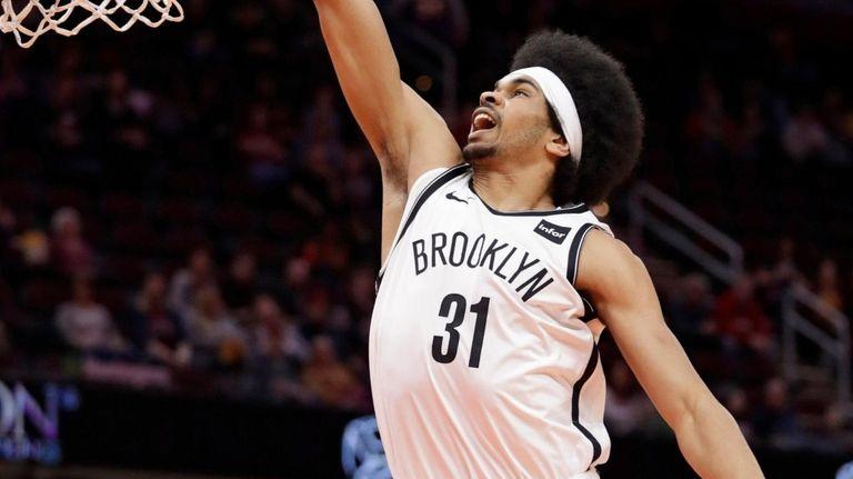 The Nets' Jarrett Allen dunks against the Cavaliers