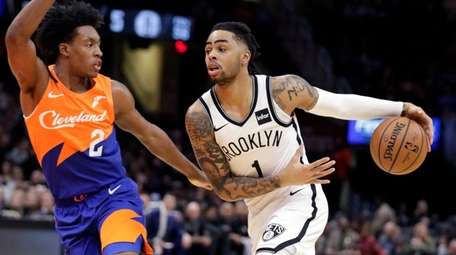 The Nets' D'Angelo Russell drives against the Cavaliers'