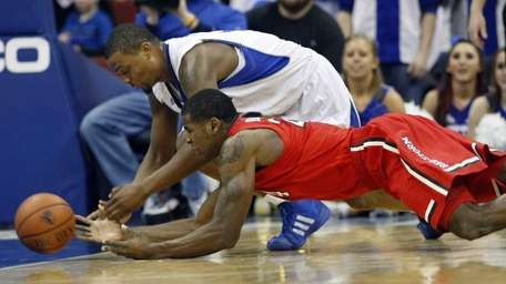 Seton Hall's Herb Pope, top, dives for the