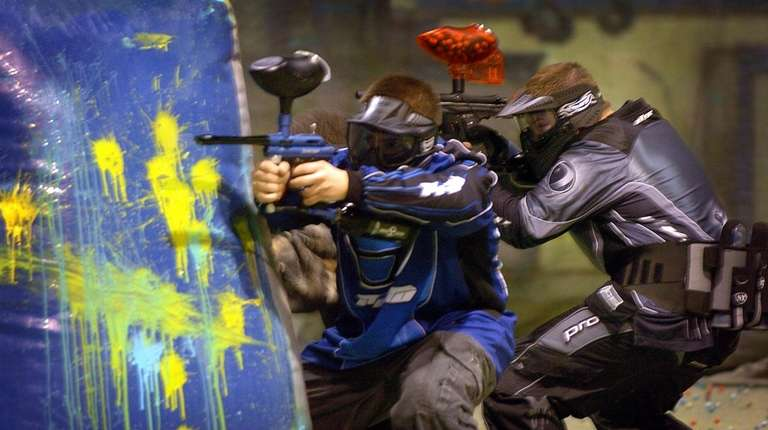 Players compete in a game of Paintball at