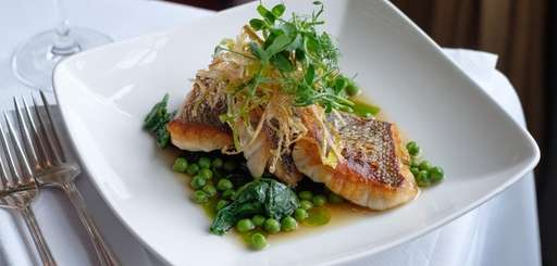 Roasted black sea bass with spring pea broth,