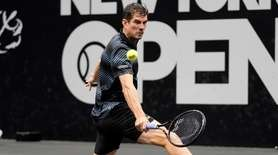 Guillermo Garcia-Lopez stretches for the backhand return against
