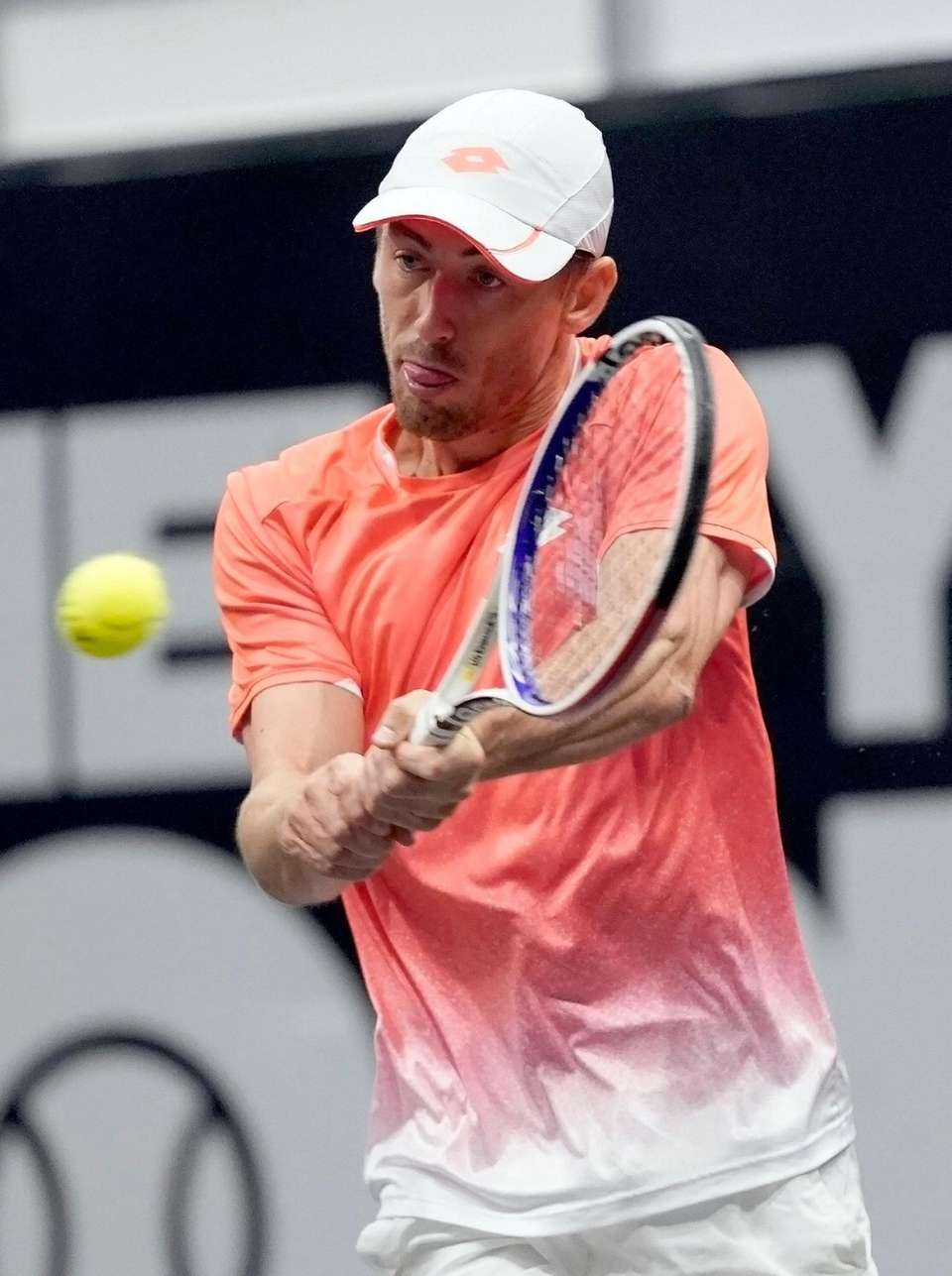 John Millman with the backhand return against Guillermo