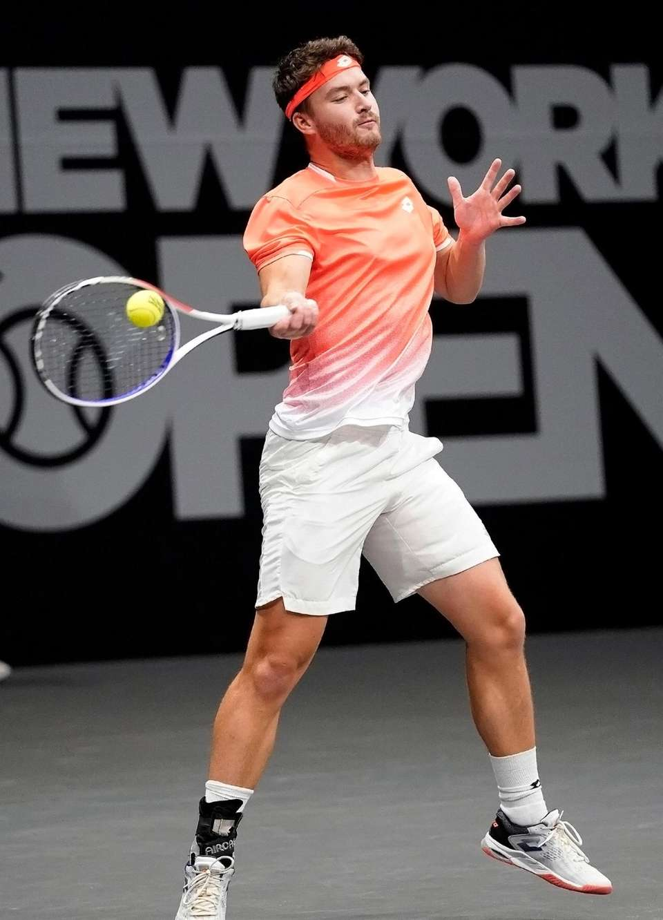 Jonny O'Mara with the forehand returnd in his