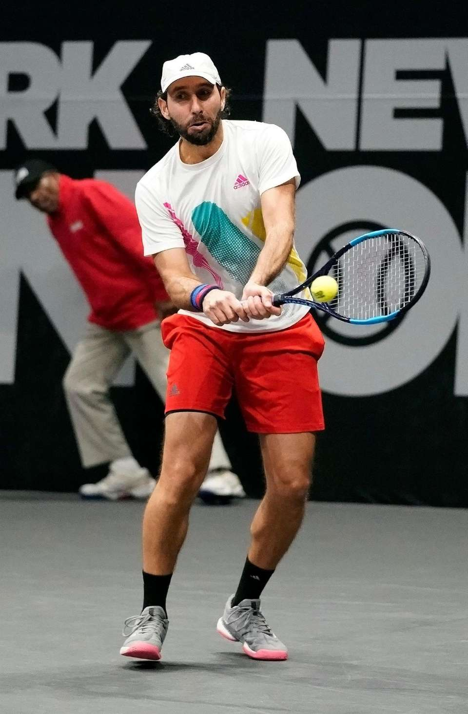 Santiago Gonzalez (l) with the backhand return in