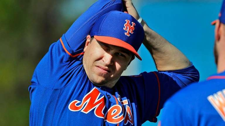 Mets pitcher Jacob deGrom, left, talks with teammate
