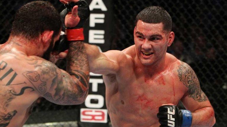 Chris Weidman punches Alessio Sakara during their middleweight