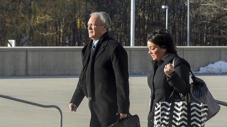 Ed and Linda Mangano arrive at federal court
