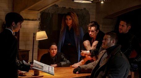Aidan Gallagher, left, Ellen Page, Emmy Raver-Lampman, Robert