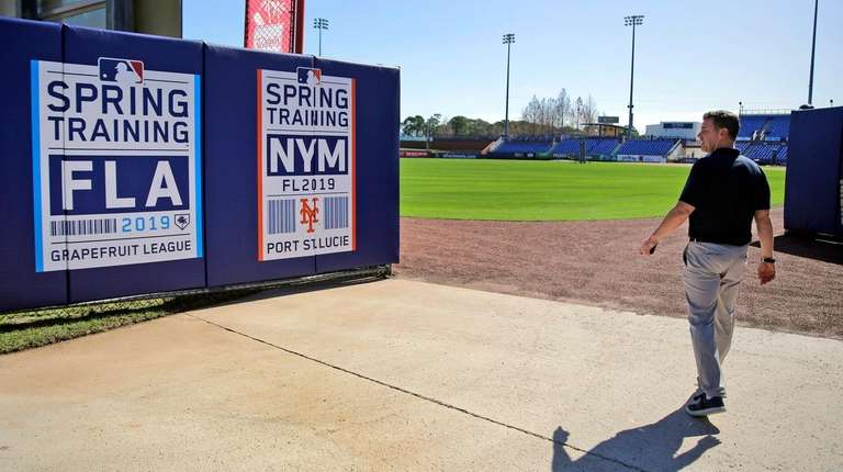 Mets general manager Brodie Van Wagenen walks through