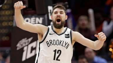 The Nets' Joe Harris celebrates in overtime after