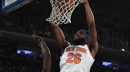 New York Knicks center Mitchell Robinson dunks against