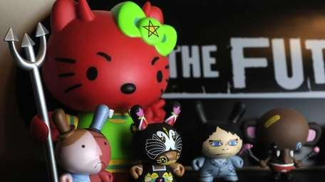 Vinyl toy collector Brandon Clark, 23, shows off