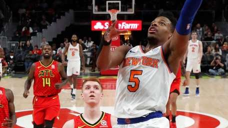 Knicks guard Dennis Smith Jr. goes in for