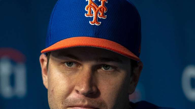 New York Mets pitcher Jacob deGrom talks to