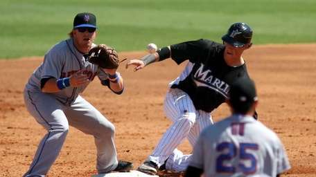Chris Coghlan #8 of the Florida Marlins slides